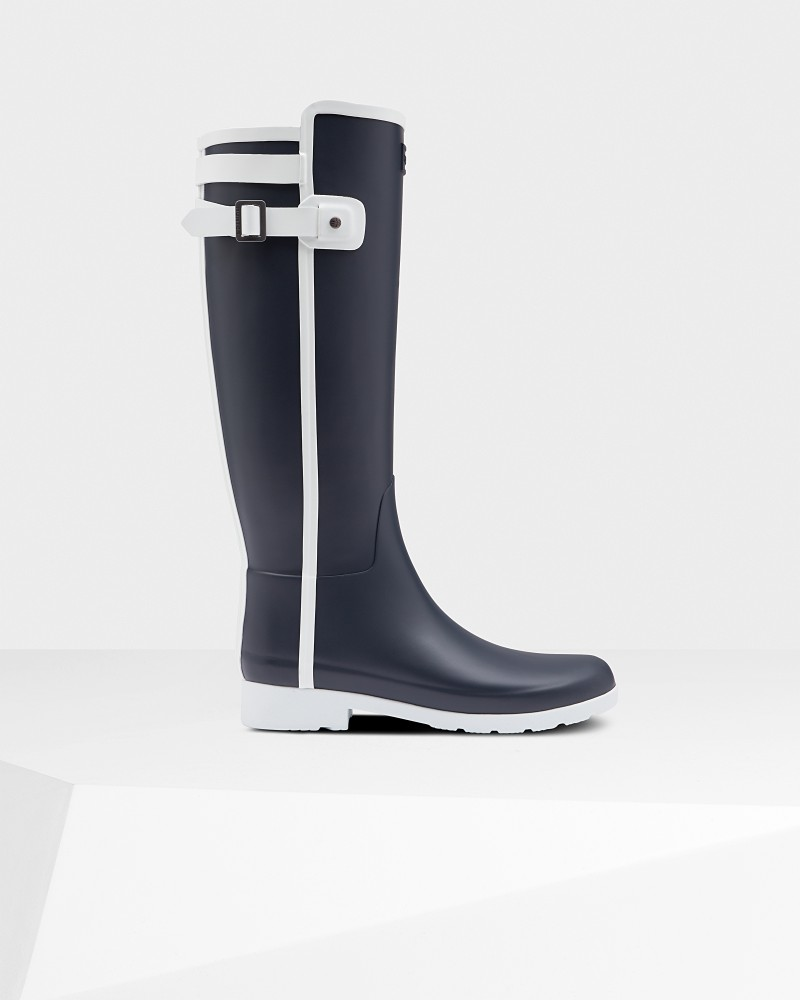 *Size/Fit Summary: True to size, Slim fit* A slim fit take on the iconic Original Tall Boot, key aspects of the style have been redesigned to create a more tailored silhouette. 100% waterproof and handcrafted using fewer layers of rubber for a lightweight feel, the Women\\\'s Refined Rain Boot Boot features a decorative contrast strap which is wrapped around and finished with a buckle, while the same white detailing features throughout the boot for a statement look. Finished in a matte navy with a